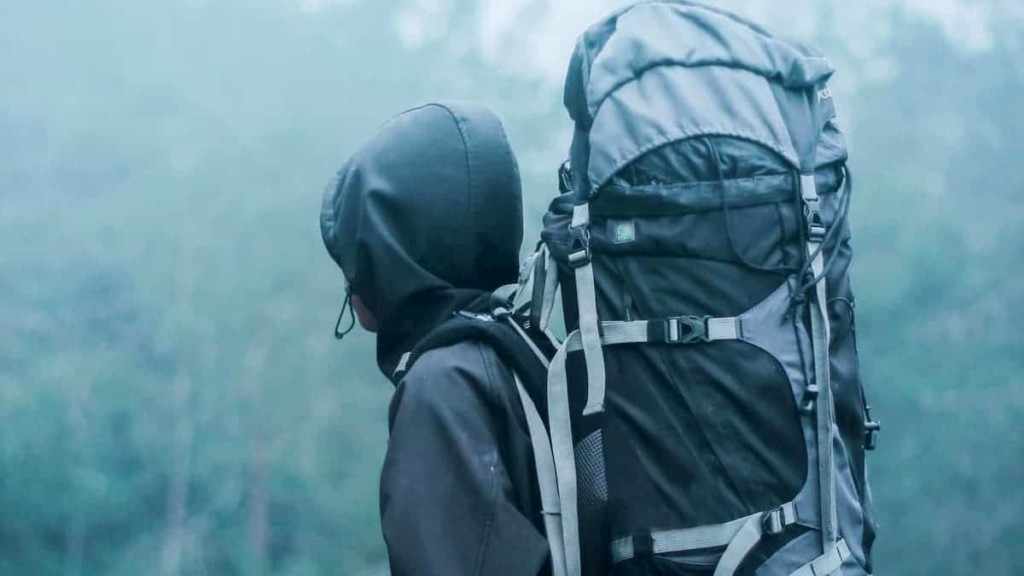 Hiking in the wet and rainy weather in the forest with pack exposed and not covered - How to Buy the Right Hiking Backpack
