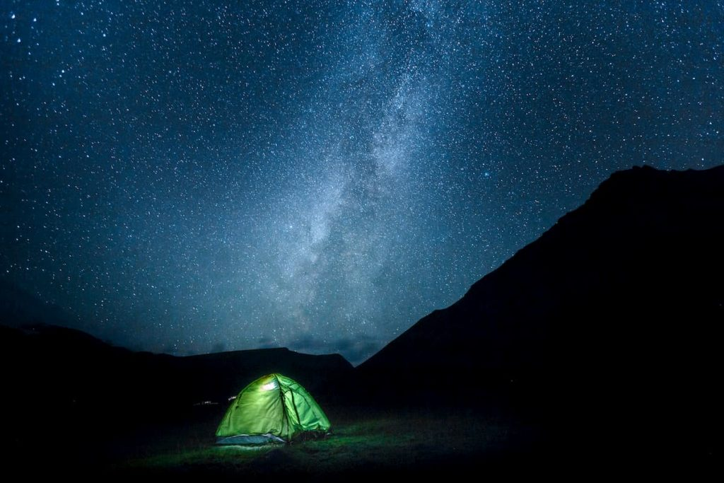 tent camping with the night sky - What Does Cowboy Camping Mean in Backpacking