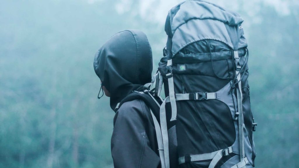 Hiking in the rain carrying a large pack - How Thru Hiking Changes You