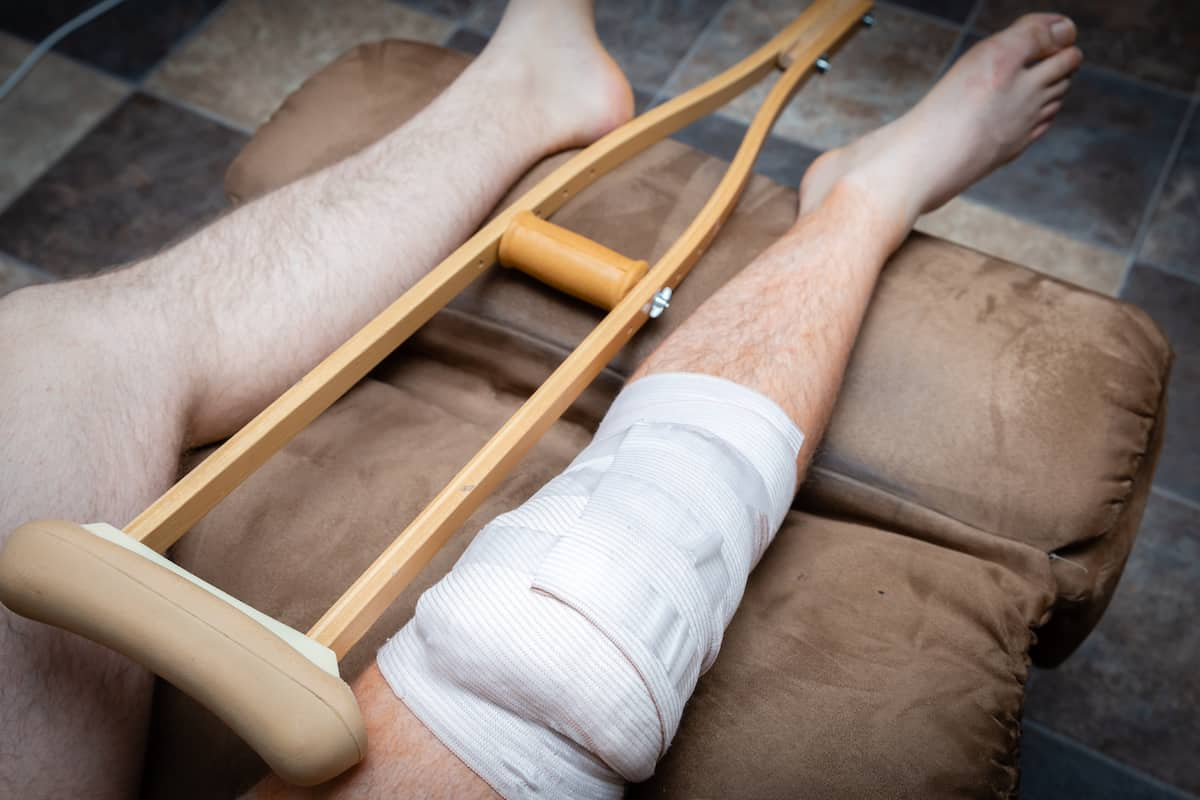 Man with his leg wrapped after knee surgery